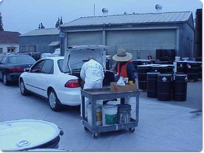 Employees rounding up household hazardous waste