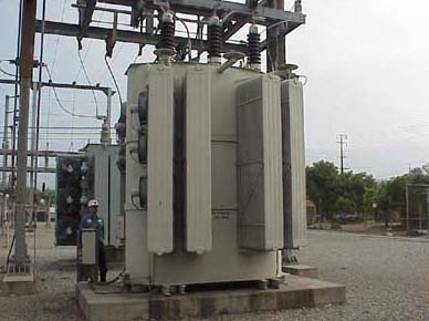 Transformer converts high voltage to a lower voltage for delivery